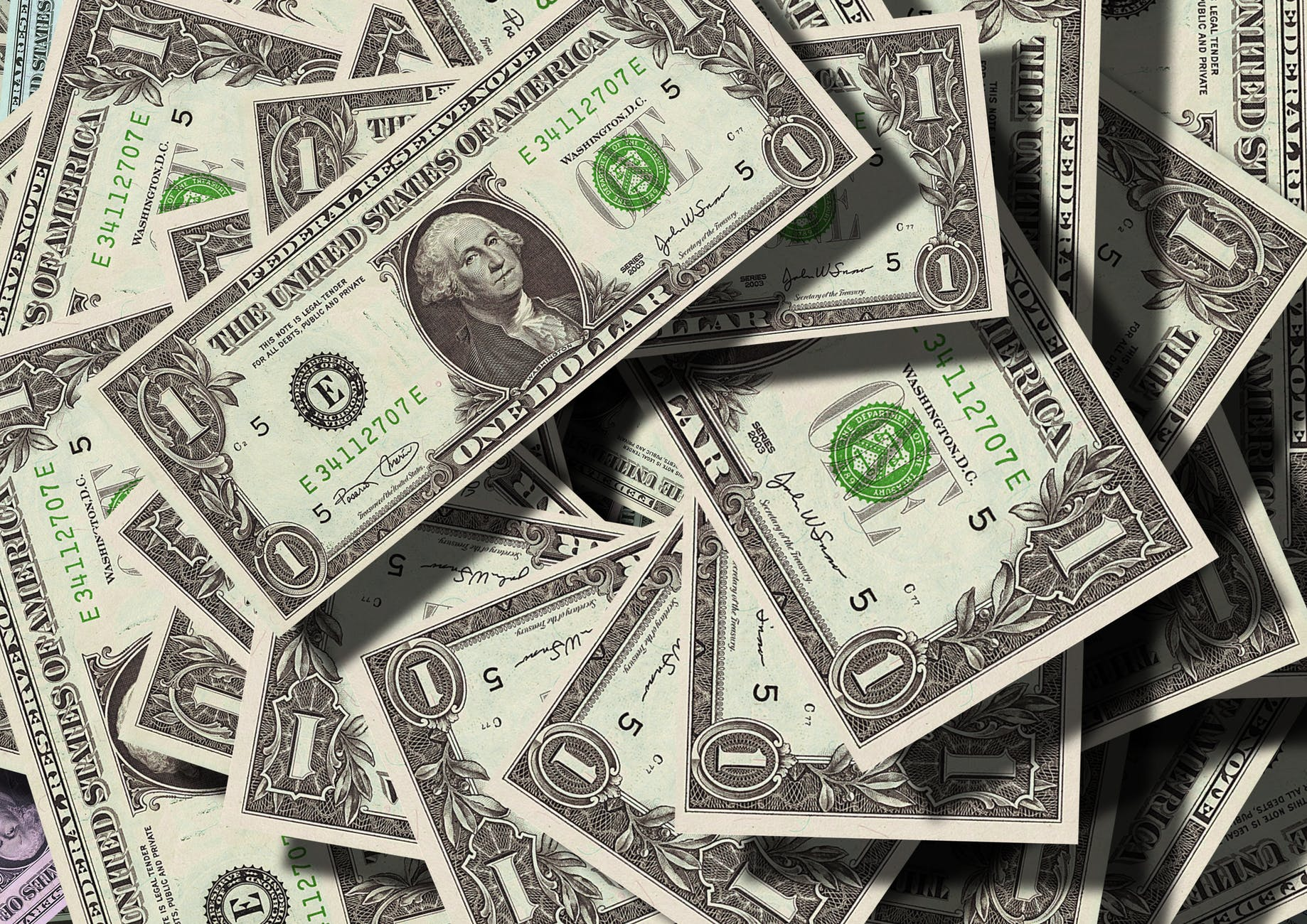 dollar bills, how to lower your insurance rates, Millennium Brokers, Springfield, MO